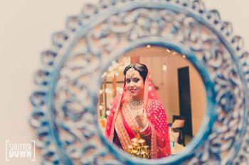 Hot Pink Bride Shot Through the Mirror