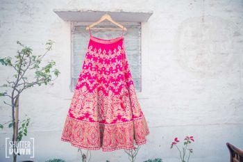 Photo of Hot Pink Bridal Lehenga on a Hanger