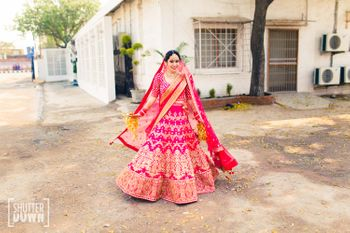 Hot Pink and Gold Bridal Twirling Lehenga