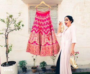 Bride with Hot Pink Lehenga on a Hanger