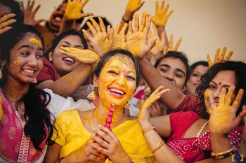 Fun haldi bridal party photo with bride