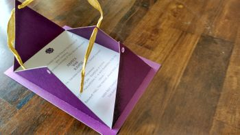 purple invitations with open flap