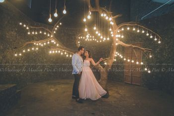Pre-Wedding Shot Under Hanging Bulbs