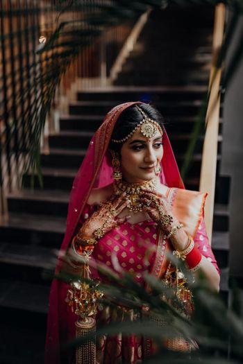 Pretty bridal portrait in a pink lehenga