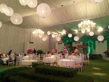 Photo of white draped ceiling with hanging lanterns