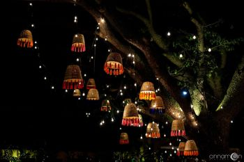 Tree decorations done with upturned baskets, tassels and bulbs.