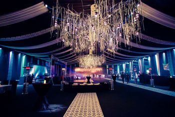 Photo of glamorous club look theme with large chandeliers