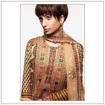 Photo of The Neo-Bohemian Modern Mehandi Outfit with Multicolored embroidery.