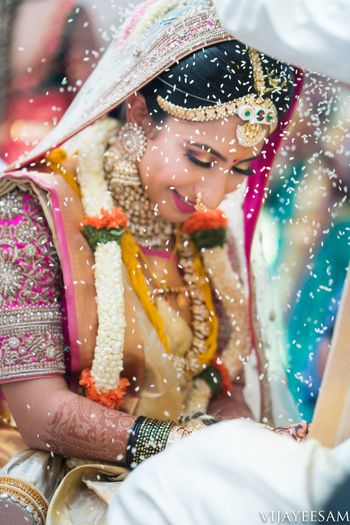Candid shot of a South Indian bride from her wedding day.