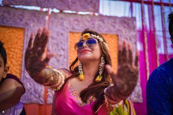 Photo of Fun Bridal Mehendi Portrait with Purple Sunglasses