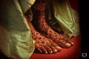 Intricate Floral Jali Mehendi on feet