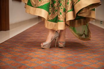 Photo of Silver Bridal Shoes with Green and Gold Lehenga