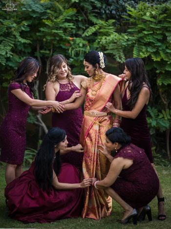 Bridesmaids helping bride get ready South Indian wedding