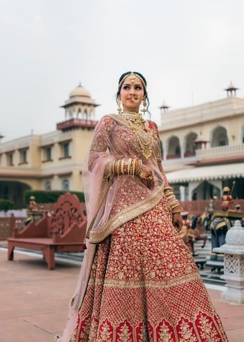 modern bridal look in red lehenga