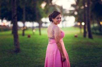 Photo of Bride Wearing Light Pink Gown with Silver Stone Work