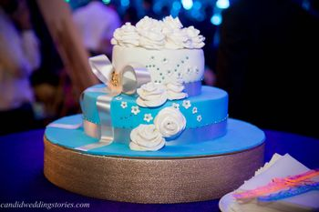 3 Tier Blue and White Wedding Cake with Florals