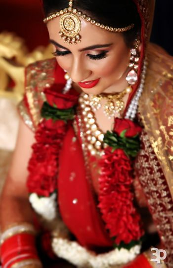 Bride Wearing Polki Jewellery and Gold Mathapatti