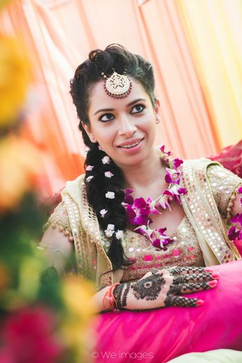 Bride with Mehendi and Orchid Floral Jewellery and Hair