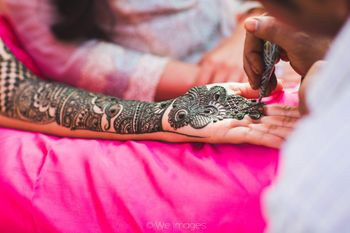 Traditional Bold Bridal Mehendi Design on Hand and Arm