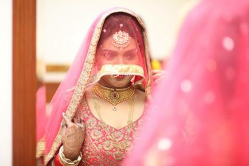 Bride Covering Face and Looking into Mirror