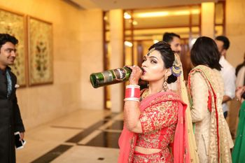 Bride in Red Posing with Whiskey Bottle
