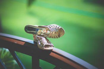 Bridal Shoes Balancing on Ledge