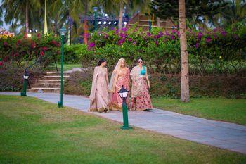 Kashmiri Bride Walking Down the Aisle with Bridesmaids