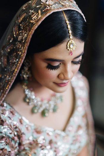 Dainty maang tikka for minimalist brides.