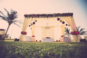 White Open Air Mandap with Floral Arrangement