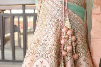 Light Pink Lehenga with Silver and Pink Ball Latkans