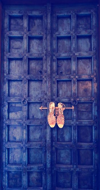 Bridal Shoes Hung on Royal Door Latch
