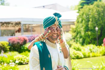 Photo of Groom in Teal and Off White Sherwani and Safa