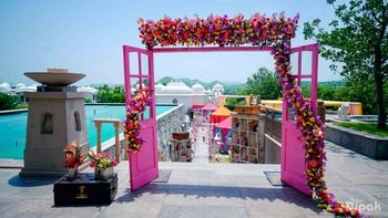 Pink Door with Florals and Vintage Suitcase