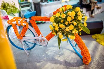 Photo of Genda Phool Cycle with Floral Arrangement Decor Prop