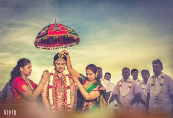 South Indian Bridal Entry Under Traditional Umbrella