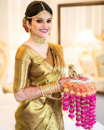 bride in gold kanjivaram