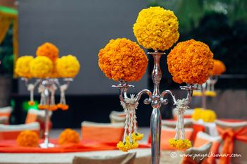 Photo of Genda Phool Candlestick as Centrepiece