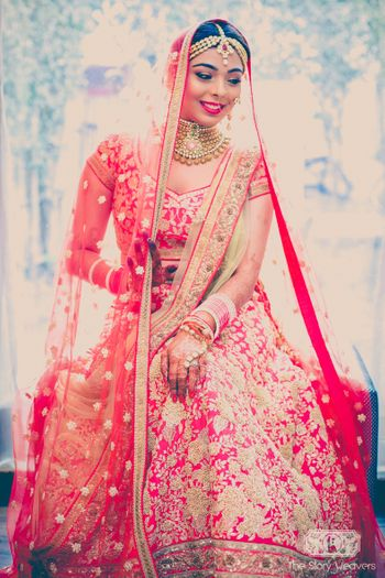 Red bridal lehenga with gold thread work