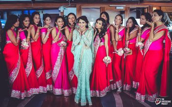 Bride with Matching Bridesmaids Wearing Pink Saris
