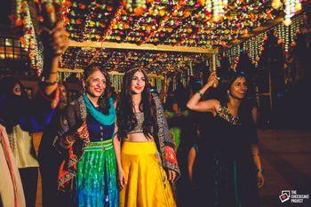 Photo of Offbeat Bridal Entry Under Phoolon ki Chadar in Yellow