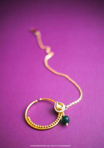 Photo of Dark Green and Gold Nath with Kundan Drop