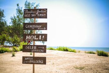 Photo of Fun Chalkboard Direction Board for Beach Wedding