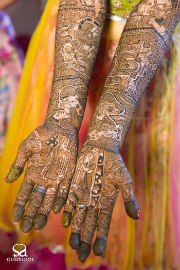 Bridal Mehendi with Rajasthani Couple Portraits Design