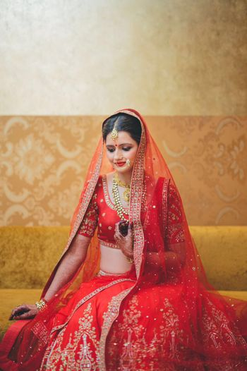 Photo of Red Bridal Lehenga with Gota and Stone Work