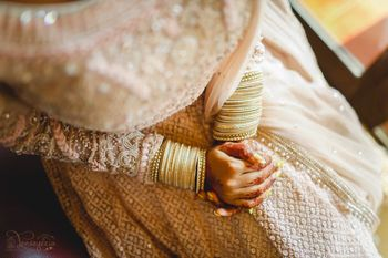 Photo of bridal hands with simple white bangles