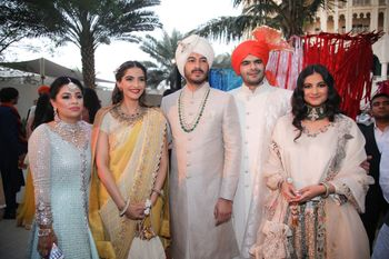 Family pose with Sonam Kapoor & Rhea Kapoor at the baraat