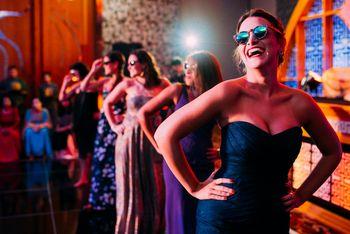 Fun Bridesmaids Photo Onstage During Sangeet