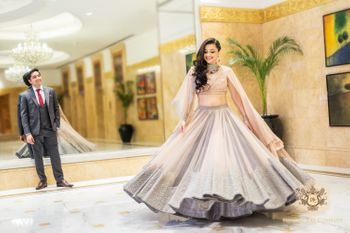Light Grey Shimmery Lehenga with Pale Pink Cape