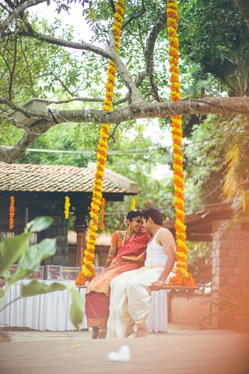 Rustic Swing with Genda Phool Decor in South Wedding