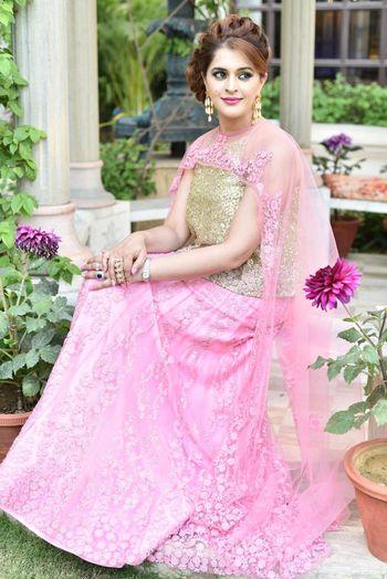 Model Wearing Light Pink Lehenga with Cape Dupatta
